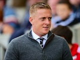 Garry Monk Manager of Swansea City looks on during the Barclays Premier League match between Swansea City and Everton at the Liberty Stadium on September 19, 2015 in Swansea, United Kingdom