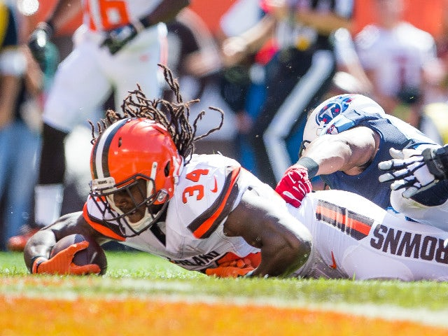Running back Isaiah Crowell #34 of the Cleveland Browns scores a touchdown against the Tennessee Titans during the first quarter at FirstEnergy Stadium on September 20, 2015 in Cleveland, Ohio.