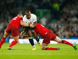 Tom Youngs (L) and Tom Wood of England (R) tackles Vereniki Goneva of Fiji during the 2015 Rugby World Cup Pool A match between England and Fiji at Twickenham Stadium on September 18, 2015 in London, United Kingdom.
