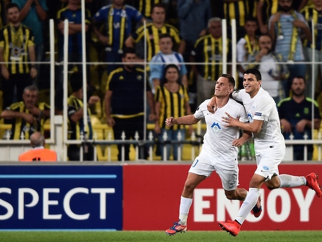 Molde's Tommy Hoiland (L) celebrates with a teammate after scoring a goal during the Europa League football match between Fenerbahce and Molde on September 17, 2015 at the Ulker Fenerbahce Sukru saracoglu stadium in istanbul.