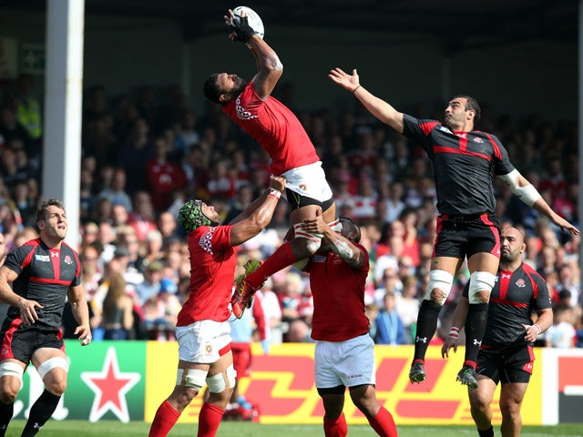 Steve Mafi of Tonga leaps for a high ball chalenged by Mamuka Gorgodze of Georgia during the Group C: Rugby World Cup match between Tonga and Georgia at Kingsholm Stadium Stadium on September 19, 2015