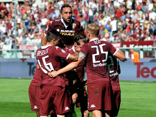Quagliarella of Torino FC celebrates his second goal with his team players during the Serie A match between Torino FC and UC Sampdoria at Stadio Olimpico di Torino on September 20, 2015
