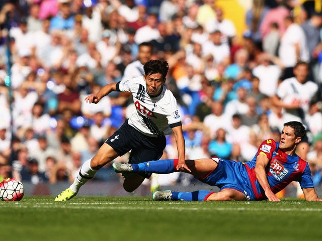 Son Heung-Min of Tottenham Hotspur is challenged by Martin Kelly of Crystal Palace during the Barclays Premier League match between Tottenham Hotspur and Crystal Palace at White Hart Lane on September 20, 2015