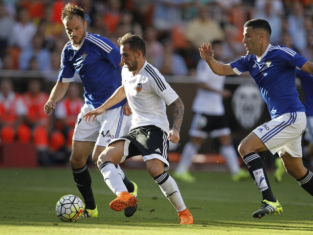 Betis' defender Bruno Gonzalez (R) and Betis' German defender Heiko Westermann (L) vie with Valencia's forward Paco Alcacer during the Spanish league football match Valencia CF vs Real Betis Balompie at the Mestalla stadium in Valencia on September 19, 20