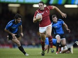 Wales' centre Cory Allen (C) runs in to score his second and Wales's third try during the Pool A match of the 2015 Rugby World Cup between Wales and Uruguay at the Millennium Stadium in Cardiff, south Wales, on September 20, 2015