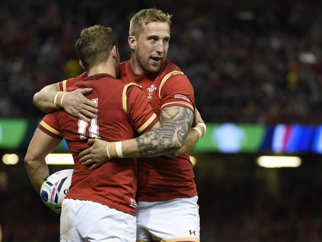 Wales' wing Hallam Amos (L) celebrates scoring Wales's fifth try during the Pool A match of the 2015 Rugby World Cup between Wales and Uruguay at the Millennium Stadium in Cardiff, south Wales, on September 20, 2015