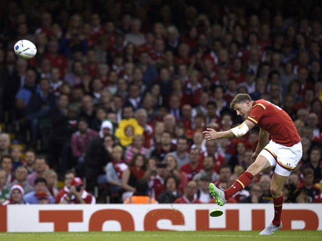 Wales' fly half Rhys Priestland kicks a conversion during the Pool A match of the 2015 Rugby World Cup between Wales and Uruguay at the Millennium Stadium in Cardiff, south Wales, on September 20, 2015
