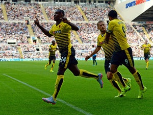 Odion Ighalo of Watford celebrates scoring his team's first goal with his team mates during the Barclays Premier League match between Newcastle United and Watford at St James' Park on September 19, 2015 in Newcastle upon Tyne, United Kingdom.
