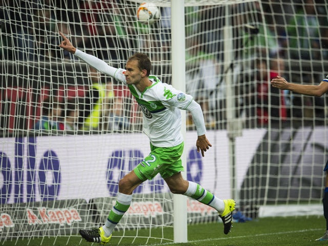 Wolfsburg's forward Bas Dost of the Netherlands celebrates scoring the opening goal during the German first division Bundesliga football match VfL Wolfsburg vs Hertha BSC Berlin, in Wolfsburg, northern Germany on September 19, 2015