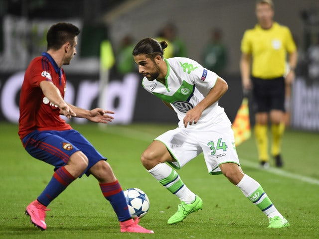 Wolfsburg's Swiss defender Ricardo Rodriguez (R) and CSKA Moscow's Serbian midfielder Zoran Tosic vie for the ball during the UEFA Champions League group B first leg football match between VfL Wolfsburg and CSKA Moscow in Wolfsburg on September 15, 2015