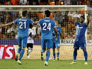 Zenit survive late Valencia fightback