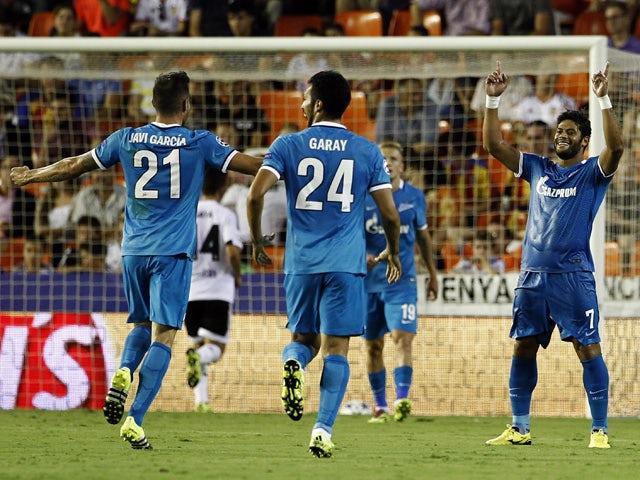 Zenit's Brazilian forward Hulk (R) celebrates his goal with teammates during the UEFA Champions League group H football match Valencia CF vs FC Zenit at the Mestalla stadium in Valencia on September 16, 2015