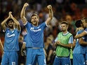 Zenit's Belgian defender Nicolas Lombaerts (2nd L) and teammate Zenit's Portuguese defender Luis Neto (L) celebrate their victoy after the UEFA Champions League group H football match Valencia CF vs FC Zenit at the Mestalla stadium in Valencia on Septembe