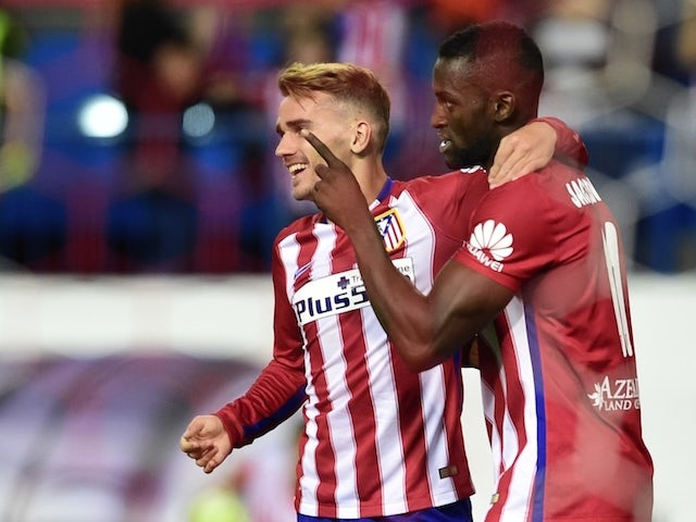 Atletico Madrid's French forward Antoine Griezmann (L) and Atletico Madrid's Colombian forward Jackson Martinez celebrate after scoring a goal during the Spanish league football match Club Atletico de Madrid vs Getafe CF at the Vicente Calderon stadium in