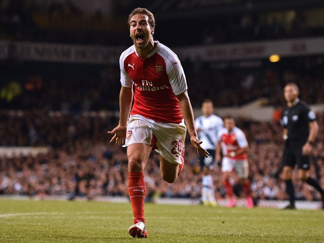 Arsenal's French midfielder Mathieu Flamini celebrates after scoring their seond goal during the English League Cup third round football match between Tottenham Hotspur and Arsenal at White Hart Lane in north London on September 23, 2015