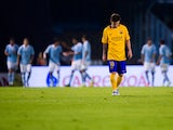 Lionel Messi of FC Barcelona looks dejected after John Guidetti of Celta Vigo scored his team's fourth goal during the La Liga match between Celta Vigo and FC Barcelona at Estadio Balaidos on September 23, 2015
