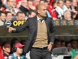 Bayern Munich's Spanish head coach Pep Guardiola reacts during the German first division Bundesliga football match 1 FSV Mainz 05 vs FC Bayern Muenchen in Mainz, southern Germany, on September 26, 2015