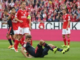 Bayern Munich's midfielder Thomas Muller misses a penalty during the German first division Bundesliga football match 1 FSV Mainz 05 vs FC Bayern Muenchen in Mainz, southern Germany, on September 26, 2015