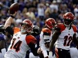 Quarterback Andy Dalton #14 of the Cincinnati Bengals celebrates with wide receiver Mohamed Sanu #12 of the Cincinnati Bengals after scoring a first quarter touchdown during a game against the Baltimore Ravens at M&T Bank Stadium on September 27, 2015 in