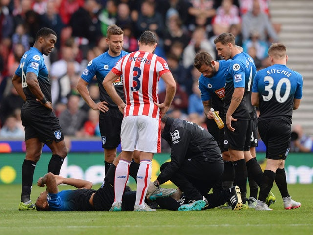 Callum Wilson of Bournemouth lies on the ground after his injury during the Barclays Premier League match between Stoke City and A.F.C. Bournemouth at Britannia Stadium on September 26, 2015
