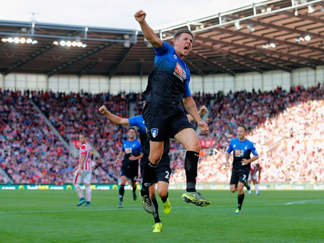 Dan Gosling of Bournemouth celebrates scoring his team's first goal during the Barclays Premier League match between Stoke City and A.F.C. Bournemouth at Britannia Stadium on September 26, 2015