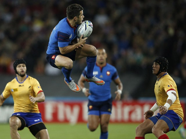 France's full-back Brice Dulin (C) jumps for the ball next to Romania's wing Adrian Apostol (R) and Romania's fly half Danut Dumbrava (L) during a Pool D match of the 2015 Rugby World Cup between France and Romania at the Olympic stadium, east London, on