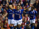 Carlisle United's Ghanaian striker Derek Asamoah (2nd L) celebrates after scoring their first goal during the English League Cup third round football match between Liverpool and Carlisle United at Anfield in Liverpool, north west England on September 23,