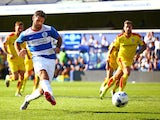 Charlie Austin of QPR scores his sides fourth goal from the penalty spot during the Sky Bet Championship match between Queens Park Rangers and Rotherham United at Loftus Road on August 22, 2015