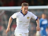 Charlie Taylor of Leeds United runs with the ball during the pre season friendly match between York City and Leeds United at Bootham Crescent on July 15, 2015 in York, England.