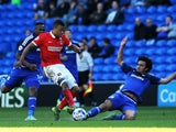 Jordan Cousins of Charlton Athletic is tackled by Fabio of Cardiff City during the Sky Bet Championship match between Cardiff City and Charlton Athletic at the Cardiff City Stadium on September 26, 2015