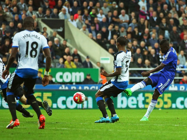 Chelsea's Brazilian midfielder Ramires (R) shoots to score their first goal during the English Premier League football match between Newcastle United and Chelsea at St James' Park in Newcastle-upon-Tyne, north east England, on September 26, 2015.