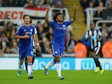 Willian of Chelsea celebrates scoring his team's second goal during the Barclays Premier League match between Newcastle United and Chelsea at St James' Park on September 26, 2015 in Newcastle upon Tyne, United Kingdom.