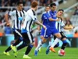 Chelseas Spanish midfielder Cesc Fabregas (2nd R) runs with the ball during the English Premier League football match between Newcastle United and Chelsea at St James' Park in Newcastle-upon-Tyne, north east England, on September 26, 2015.