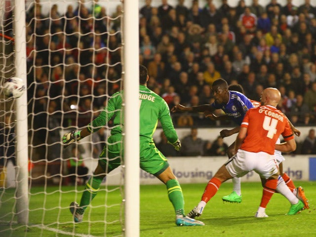 Ramires of Chelsea (C) beats Neil Etheridge and James O'Connor of Walsall (4) to score their first goal during the Capital One Cup third round match between Walsall and Chelsea at Banks's Stadium on September 23, 2015