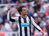 Daryl Janmaat of Newcastle United celebrates scoring his team's first goal during the Barclays Premier League match between Newcastle United and Watford at St James' Park on September 19, 2015