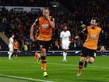 David Meyler of Hull City celebrates scoring the opening goal with Andrew Robertson of Hull City during the Capital One Cup third round match between Hull City and Swansea City at KC Stadium on September 22, 2015 in Hull, England.