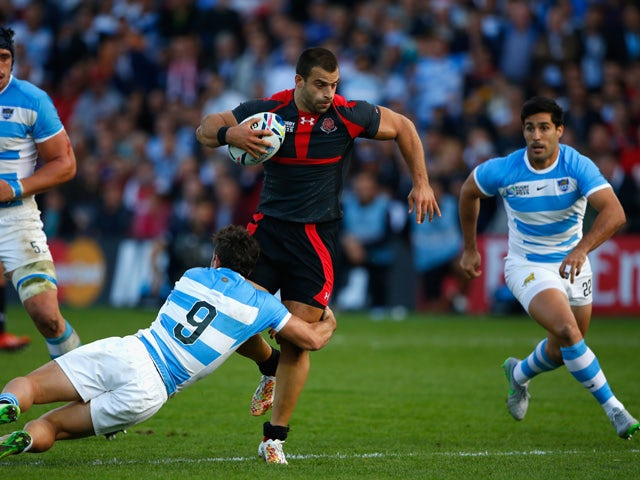 Argentina scrum half Tomas Cubelli tackles Georgia centre Davit Kacharava during the 2015 Rugby World Cup Pool C match between Argentina and Georgia at Kingsholm Stadium on September 25, 2015