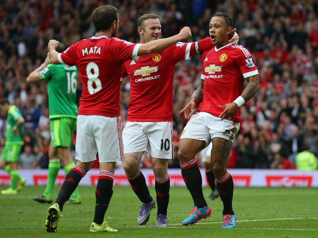 Memphis Depay (R) of Manchester United celebrates scoring his team's first goal with his team mate Juan Mata (L) and Wayne Rooney (C) during the Barclays Premier League match between Manchester United and Sunderland at Old Trafford on September 26, 2015 i