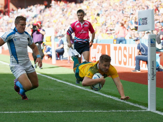 Drew Mitchell of Australia dives over to score their seventh try during the 2015 Rugby World Cup Pool A match between Australia and Uruguay at Villa Park on September 27, 2015