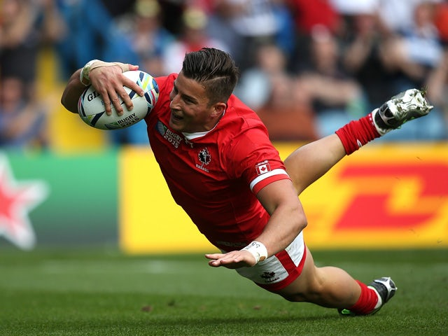 D.T.H van der Merwe of Canada goes over for the opening try during the 2015 Rugby World Cup Pool D match between Italy and Canada at Elland Road on September 26, 2015