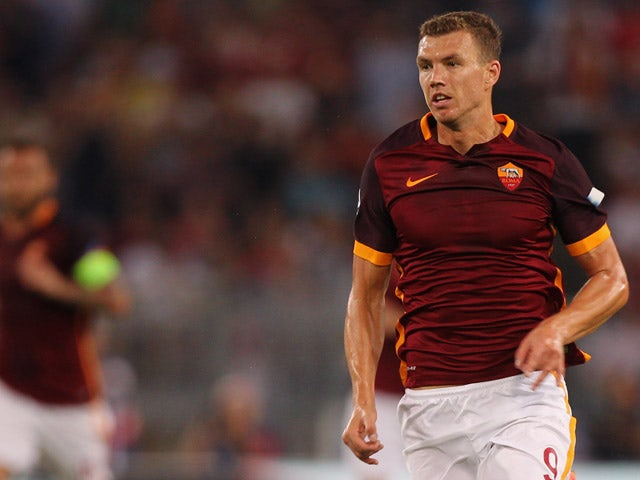 Edin Dzeko of AS Roma in action during the UEFA Champions League Group E match between AS Roma and FC Barcelona at Stadio Olimpico on September 16, 2015