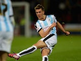 Emyr Huws of Huddersfield Town scores his team's first goal during the Sky Bet Championship match between Huddersfield Town and Nottingham Forest at John Smiths Stadium on September 24, 2015 in Huddersfield, England.