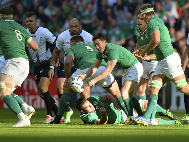 Ireland's scrum half Eoin Reddan (C) passes the ball during a Pool D match of the 2015 Rugby World Cup between Ireland and Romania at Wembley stadium, north London, on September 27, 2015