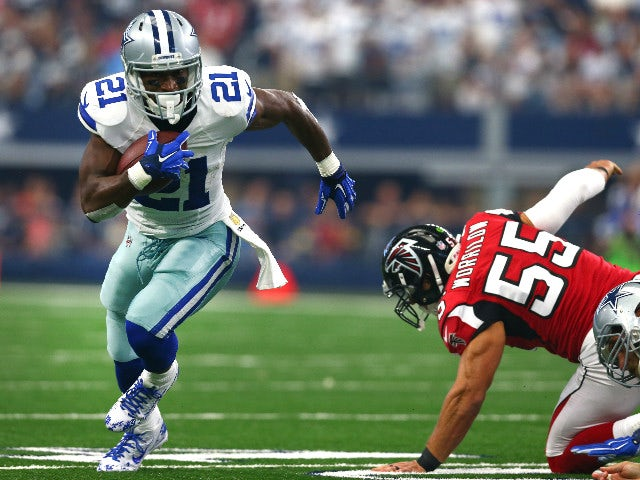 Joseph Randle #21 of the Dallas Cowboys gets past Paul Worrilow #55 of the Atlanta Falcons to score a touchdown in the first quarter at AT&T Stadium on September 27, 2015 in Arlington, Texas.