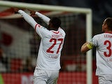 FC Koln French forward Anthony Modeste (L) celebrates scoring with Cologne's midfielder Matthias Lehmann during the German first division Bundesliga football match FC Koln vs FC Ingolstadt 04 in Cologne, western Germany on September 25, 2015