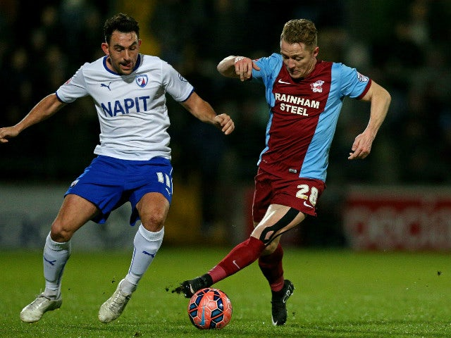 Gary McSheffrey of Scunthorpe is challenged by Gary Roberts of Chesterfield during the FA Cup Third Round match between Scunthorpe United and Chesterfield FC at Glanford Park on January 6, 2015 in Scunthorpe, England.
