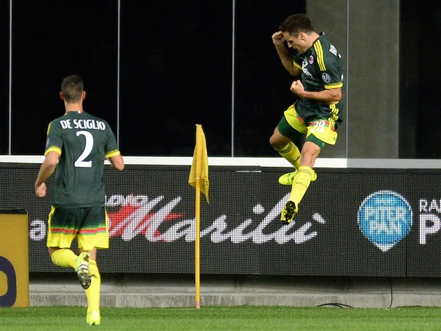 Giacomo Bonaventura of AC Milan celebrates after scoring his team's second goal during the Serie A match between Udinese Calcio and AC Milan at Stadio Friuli on September 22, 2015 in Udine, Italy.