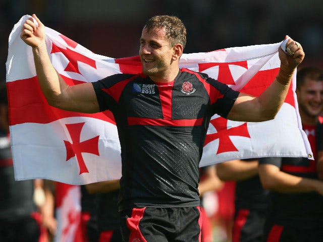 Giorgi Nemsadze of Georgia celebrates with his national flag after his team won the 2015 Rugby World Cup Pool C match between Tonga and Georgia at Kingsholm Stadium on September 19, 2015 in Gloucester, United Kingdom.