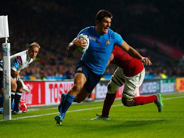 Giovanbattista Venditti of Italy scores his team's first try during the 2015 Rugby World Cup Pool D match between France and Italy at Twickenham Stadium on September 19, 2015
