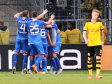 Hoffenheim's players celebrate Hoffenheim's midfielder Sebastian Rudy scoring the 1-0 during the German first division Bundesliga football match TSG 1899 Hoffenheim vs Borussia Dortmund in Sinsheim, on September 23, 2015